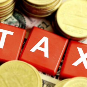 Расчет налогов с компенсации